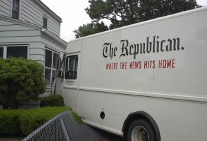 """Springfield Republican truck with the slogan """"where the news hits home"""" on the side hits a house."""